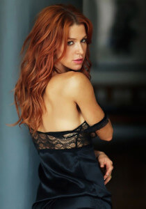redhead in black lingerie